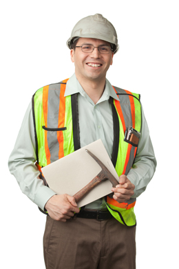 Worker with hardhat, reflective vest and rock pick
