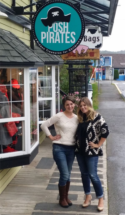 Denise and Kim in front of their shop